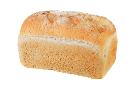 Close-up of crusty white farmhouse bread isolated on a white background