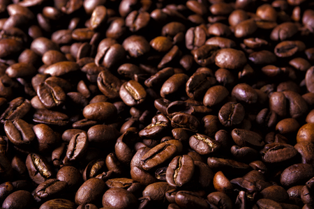 Close-up of roasted coffee beans. Selective focus