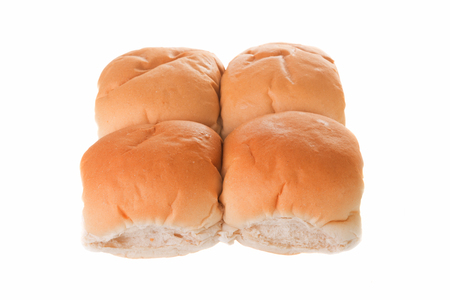 Four breakfast rolls isolated on a white background