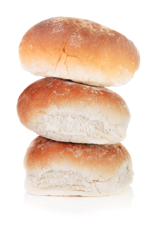 A stack of breakfast rolls isolated on a white background