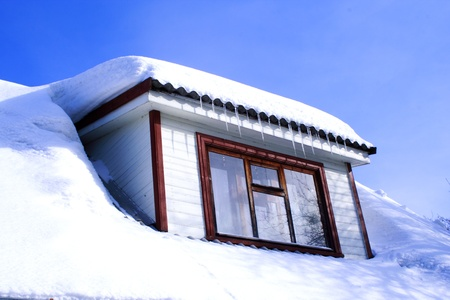 cold winter house with wondow close up Stock Photo