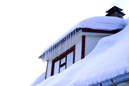 roof top: cold winter house with wondow close up Stock Photo