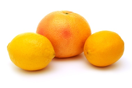 two lemons and grapefruit isolated on white photo