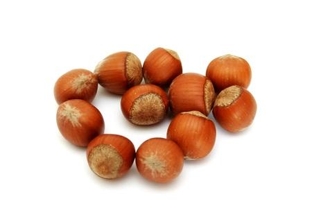 Shot of hazelnuts isolated on white background photo