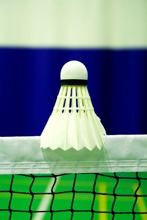 shot of badminton shuttlecock  on the net Stock Photo