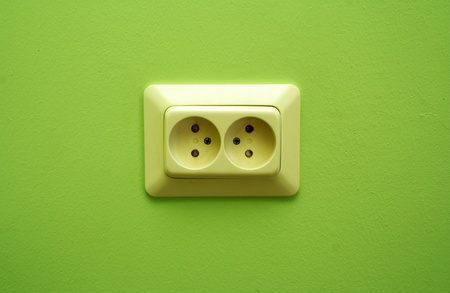 grounded plug: White electric socket on the wall close up