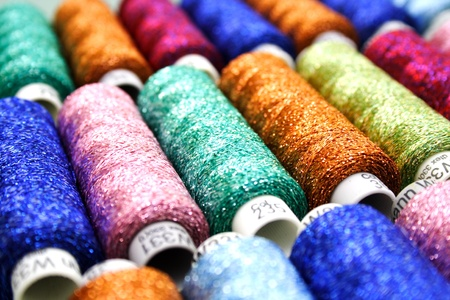 lurex: Set of coloured bobbins of lurex thread