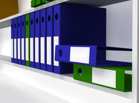Green and blue folders laying on gray shelf