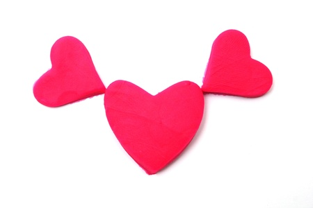 Painted to pink hearts of plasticine on background photo