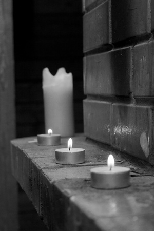 White black foto maded  about candles on fireplace photo