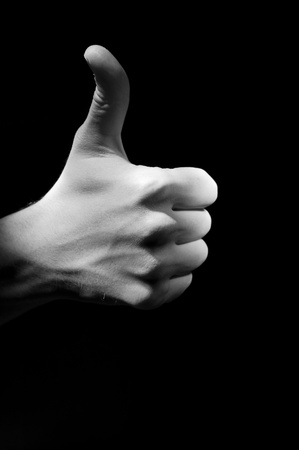 sidelong: One hand fingers with upped big one foto Stock Photo