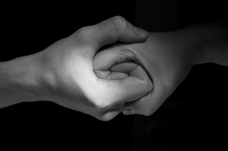 Two hands unite with eachother in special symbol