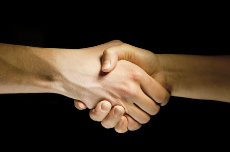 lighted: Lighted two hands unite with eachother as agreement