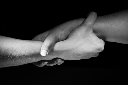 Two hands unite with eachother as friends greeting