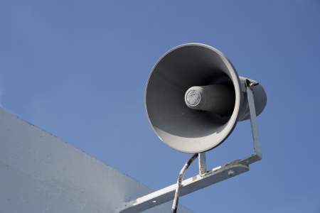loudhailer: Isolated megaphone making loud noise at sunny day