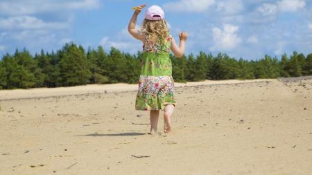 Girl play in clean sea beach and run photo