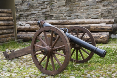 courtyard: Ancient cannon maded from cast iron on courtyard Stock Photo