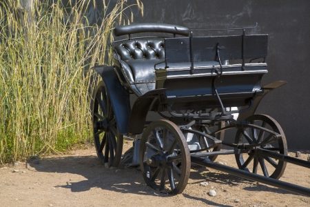 Black wagon without horses is abandoned by driver photo