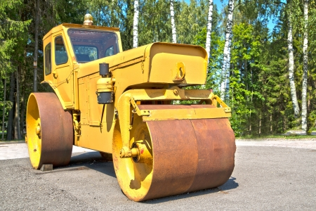 smoother: Big machine with its cylinder for smooth asphalt Stock Photo