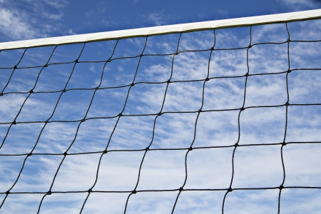 strained: Volleyball net is strained tightly for coming game