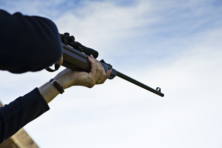 dead duck: Sniper targeting with hand weapon through optical sight Stock Photo