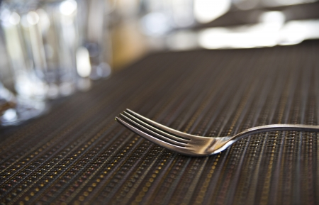 Lonely chromed fork on kitche table is washed photo