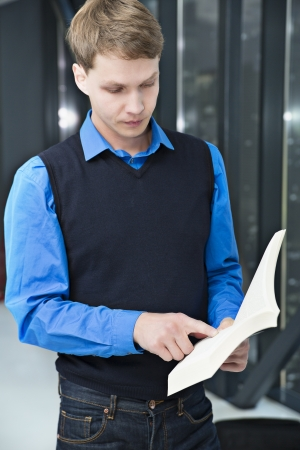 Student reading some sentences from book to remember Stock Photo - 15434313