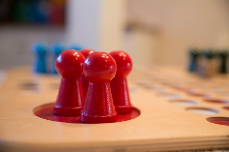 zoomed: Zoomed red buttons on table game field corner Stock Photo