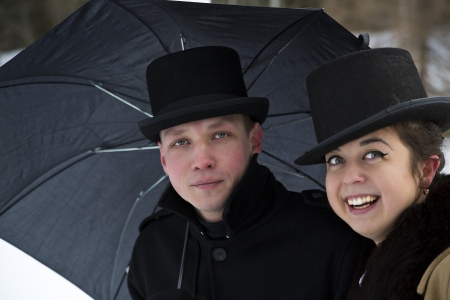 Tired man and happy woman under common umbrella photo