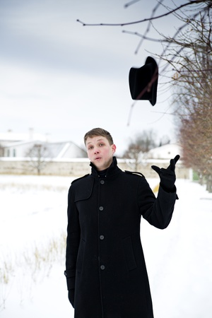Young man threw hat in air for fun Stock Photo - 17785477