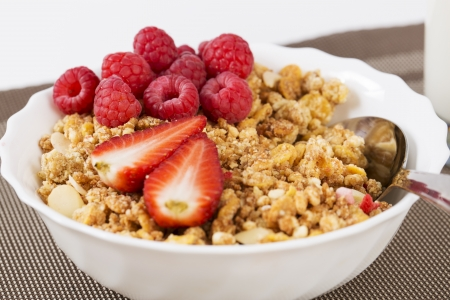 zoomed in: Zoomed halfs of berrie on cereals in bowl Stock Photo