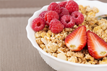musli: Zoomed view on golden cereals with berrie halfs Stock Photo