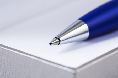 zoomed: Zoomed pen chrome head on block of papers Stock Photo