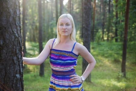 zoomed in: Zoomed woman in lined dress on forest background Stock Photo