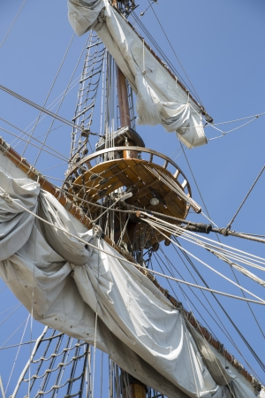 High mast with collected sails at windy day photo