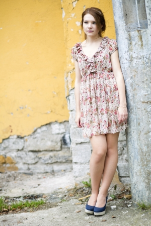 flowered: Young woman in flowered dress waiting some friend