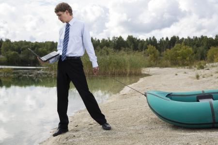 beardless: Dressed man plan drags boat at lake surface