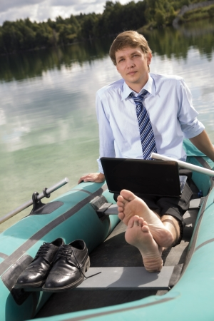 Dressed man in boat rest at sunny weather photo