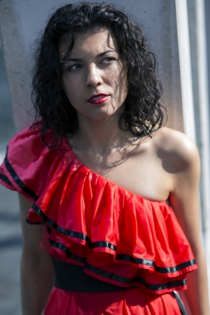 zoomed in: Zoomed face  of woman in soaking wet dress Stock Photo