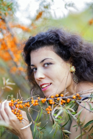 nice looking: Nice looking young woman hold branch with gooseberries