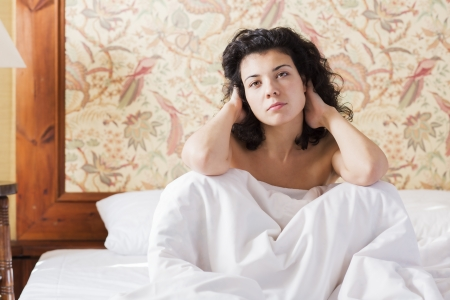 restless: Woman adjust hairs in bed after restless night