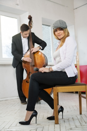 While man play contrabass woman sit at chair photo