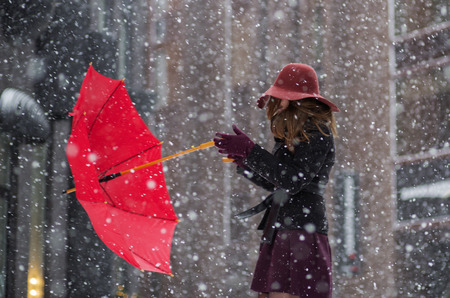 Strong wind try torn from the hands umbrella Stock Photo