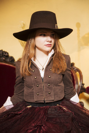 Surprised young woman dressed at old fashioned dress photo