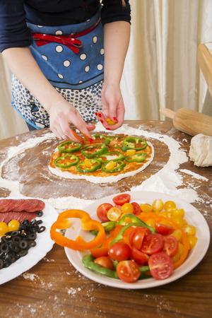 Many vegetables on slim pastry for vegan pizza photo