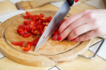 Red paprika sliced to small pieces for pizza photo