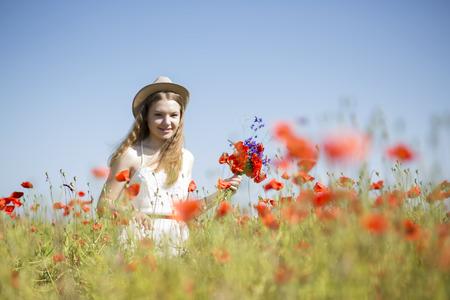 beatiful: Young woman  at white dress found beatiful flower