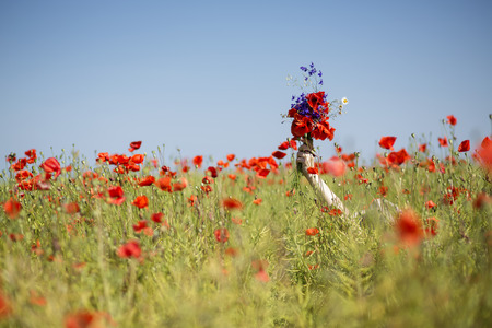drowns: Young woman  at dress drowns in poppy field