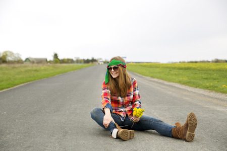 another way: Young woman with yellow flowers look another way Stock Photo