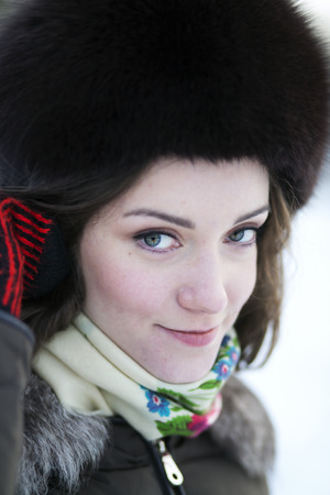 zoomed in: Zoomed female face in the hat with fur